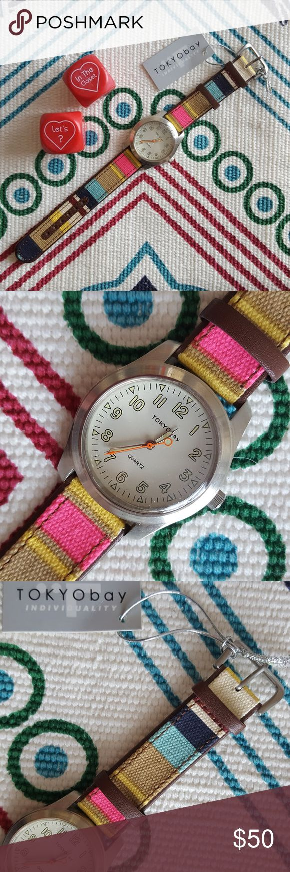 TOKYOBay Watch-Multi Colored Canvas Band Tokyo Bay Watch-Multi Colored Canvas & Genuine Leather Band.  New w/tags.  Plastic protection covering still on watch glass face.  Has been stored, new battery needed. No trades. TOKYObay Accessories Watches