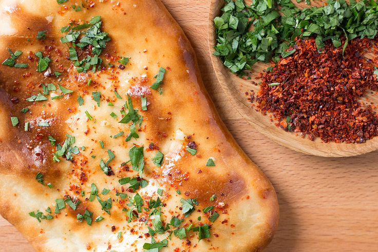 This delicious vegan naan bread uses almond milk and coconut cream in the bread and olive oil, garlic, chili and parsley to coat the bread itself. Yum!