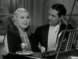 Cary Grant plays the role of Jack Clayton, an aristocrat who falls for this floozie from the wrong side of the tracks. A very young Cary Grant plays the object of Mae's affections and Edward Arnold is the circus owner and Mae's employer.  The 29 year- old Cary Grant is ONE of her many love interests and he's the guy she ends up with.