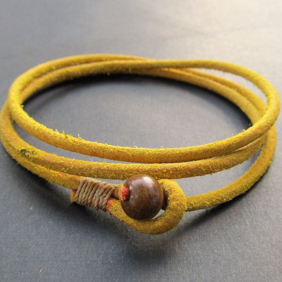 Yellow leather wrap bracelet - would look great with a polymer clay bead as the closure of course ;)