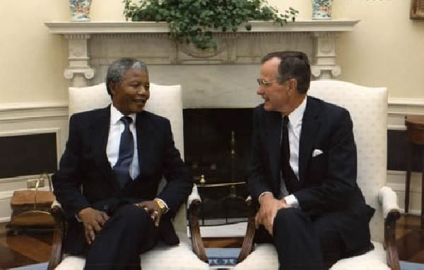 President Bush and Nelson Manedla visit in the Oval Office of the White House, Washington, DC. 06/25/1990. Courtesy of the George H. W. Bush Presidential Library. Archives Identifier: # P13952-12