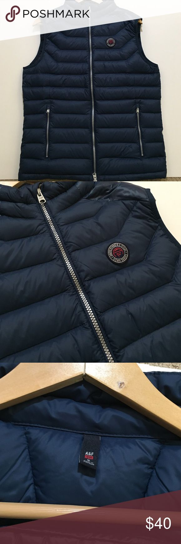 SALE! BNWOT Navy Abercrombie & Fitch Puffer Vest This navy, puffer vest from Abercrombie & Fitch is in perfect condition! It features two pockets on the front and one on the inside. Premium, super warm 700-fill-power Down offers ideal warmth to weight. Water resistant shell and highly compressible, this vest is perfect for Winter travel! Abercrombie & Fitch Jackets & Coats Vests