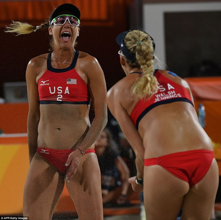 USA's April Ross (left) and Kerri Walsh Jennings (right) get each other pumped up during the match