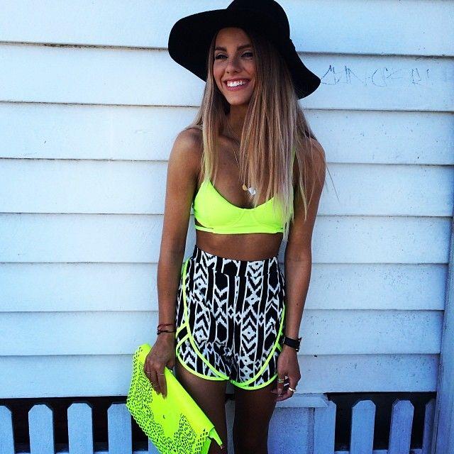 neon top, tribal shorts, floppy hat