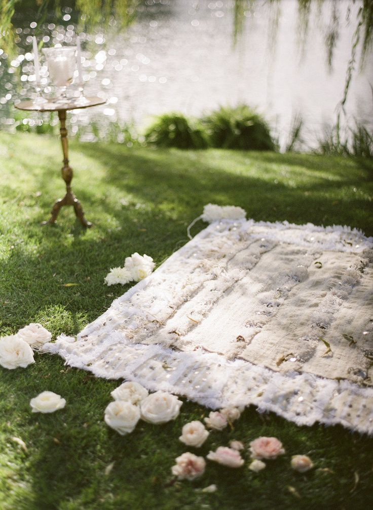 Moroccan blanket ceremony decor  Photography: Gia Canali - giacanali.com Event Design and Production: Yifat Oren & Associates - yifatoren.com/ Florals: The Velvet Garden - thevelvetgarden.com/  Read More: http://www.stylemepretty.com/2013/05/09/molly-sims-wedding-from-gia-canali-part-ii/