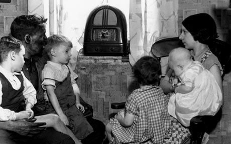 """""""A photograph of a family gather around their radio in the #1930's"""". During the Great Depression, radio was a great entertainment value when people struggle to live. 1930s was the golden era of the radio. It was took a piece of furniture in the living room of the average family."""