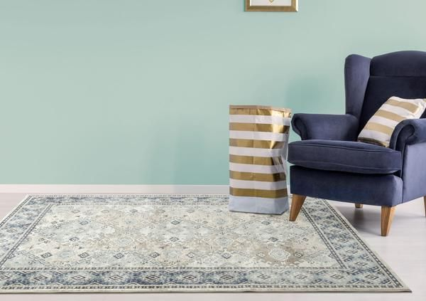 The Cebu 755 Beige Blue Border Faded Traditional Patterned Rug is a high quality, traditionally styled rug perfect any living room in your home or for your office: