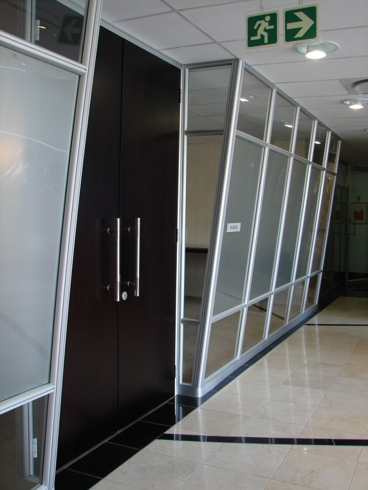Slanted 50mm solid demountable panels with a solid door.