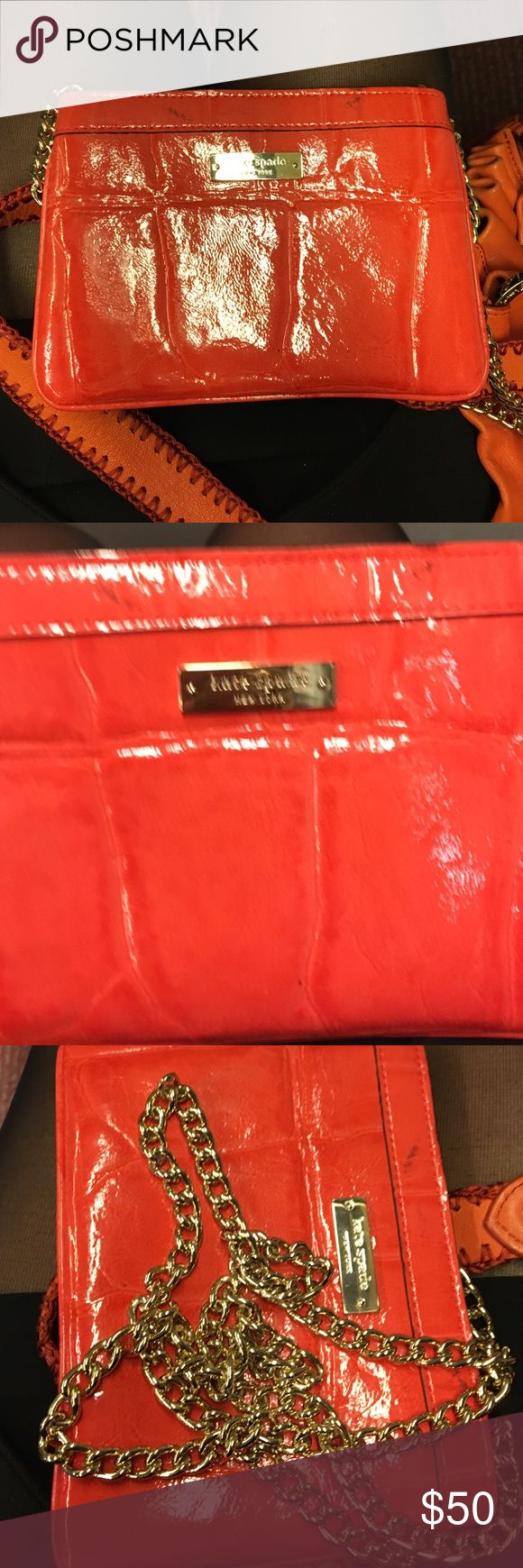 Red Kate spade mini crossover I love this little cutie but I travel with many things all the time. Great for a night out. Clean interior, marks on the outside 6 1/2 inches 5inches long kate spade Bags Clutches & Wristlets