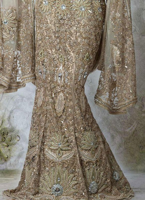Stunning Champagne beadwork in this lengha skirt, however if I am thinking of champagne or gold for my ceremony dress I think I should make the most of using colour in my reception dress?