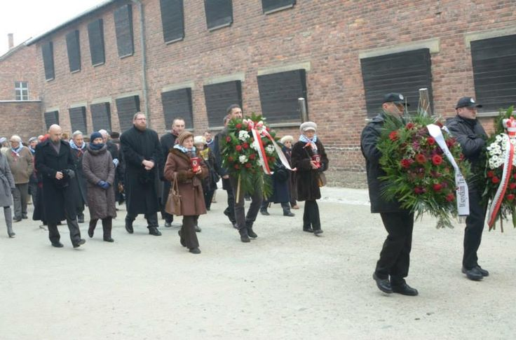 Former prisoners and Auschwitz Memorial  director and staff paying tribute to the victims of Auschwitz placing wreaths at the Death Wall.