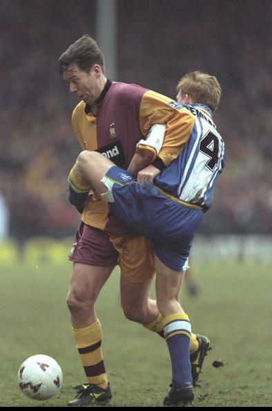 Bradford C. 0 Sheffield W. 1 in Feb 1997 at Valley Parade. Chris Waddle gets in a tangle with Mark Pembridge in the FA Cup 5th Round.