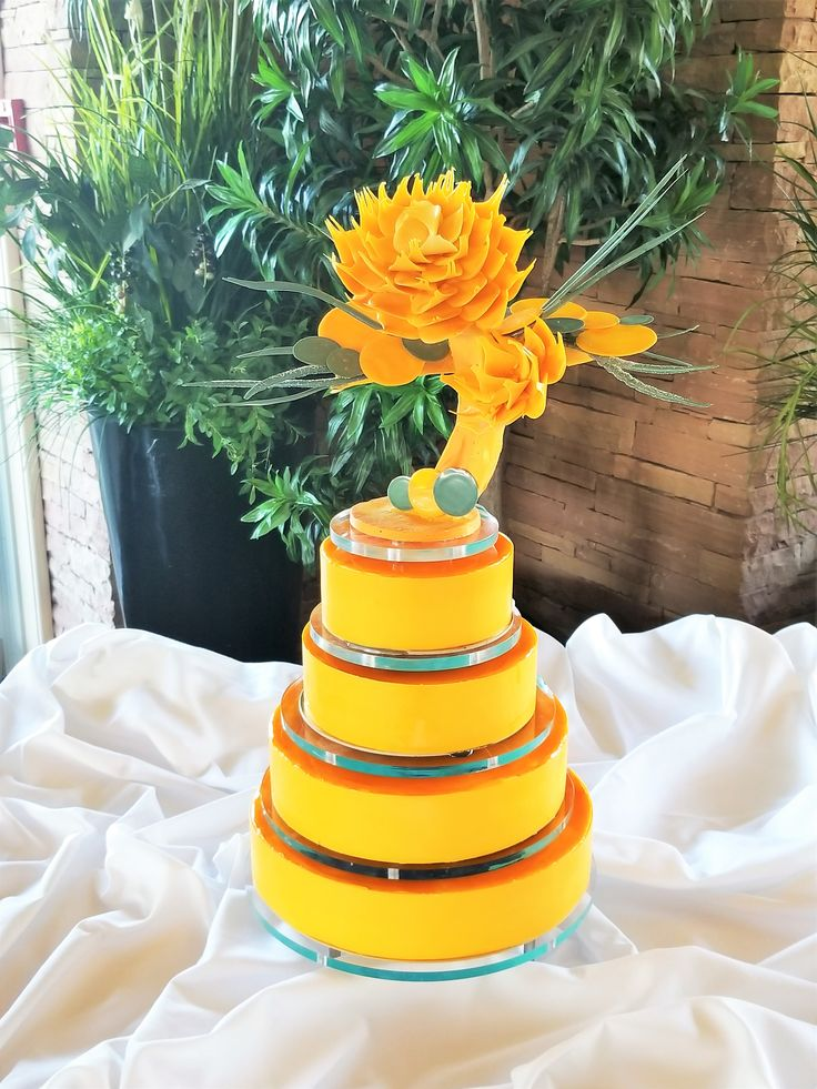 Modern wedding cake designed by chef Yann Blanchard , Calgary. This chocolate flower is stunning & one guests will remember. #yannpins #weddingcakes