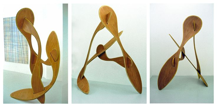 """FIGHTING WITH INSTRUMENT (Plywood construction,180cm x 100cm x 85cm, Dirk Marwig 1996) *The construction of this object from 1996 is so simple: 4 cut and shaped pieces of 12mm plywood connected where the slots are. It was easy to take apart and to set up, to transport and to store. I always put it up by myself and I looked like the object itself (or as if I was playing """"Twister"""") I made two of this object."""