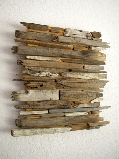 Use old cabinet doors to glue the wood onto, add a wall hanger and you have wall art.