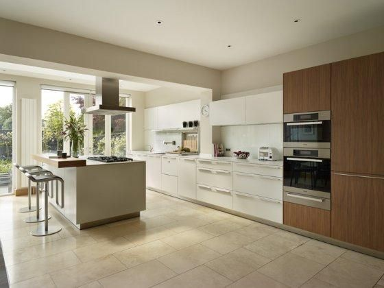 White & wood kitchen with limestone floor