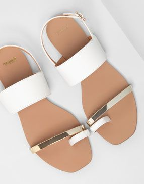 White and gold sandals.