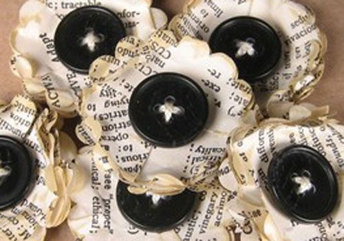Handmade memorial favors with buttons and vintage paperbacks. LOVE!!