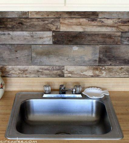 Kitchen remodel with a pallet wood backsplash.   Remodelaholic