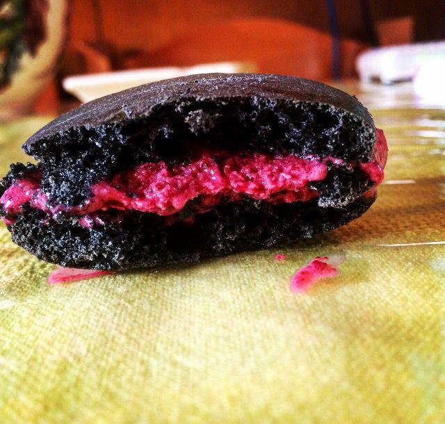 Black tie macaron filled with blueberry ice cream