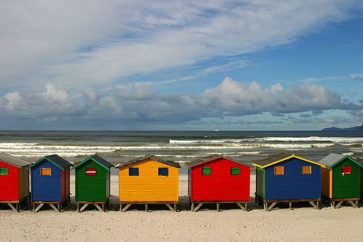 Mar 26, 2015 - Row of colorful beach houses in Muizenberg near Cape Town, South Africa.on a Hot summer day you can take a swim by False Bay on Indian Ocean coast.