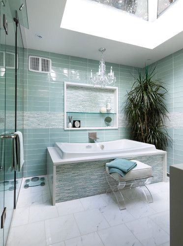 Master Bath combines natural stone (white marble floor) with aqua glass tile and mosaic for classic meets modern style.