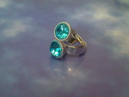 Turquoise Adjustable Shell Ring Item #: RING-0003 In Stock Color: Silver/Turquoise Material: Silver Plated Epoxy and polymer clay  are used to set the turquoise rhinestone to the ring finding.