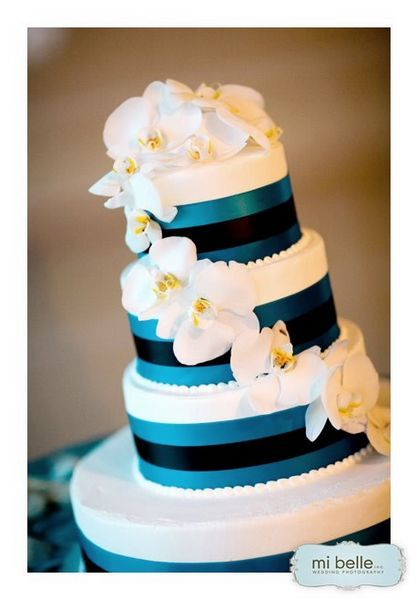 blue ribbon and orchid wedding cake.