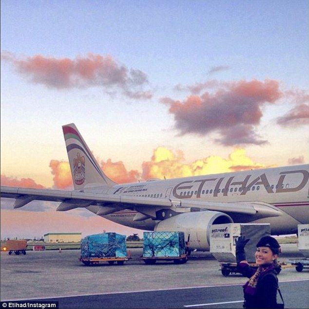 Etihad posted this photo of a flight attendant posing in front of its planes  and invited
