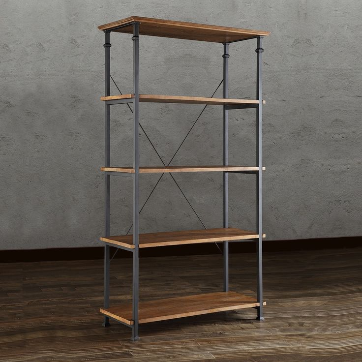This Myra Bookcase has a weathered and timeworn patina allowing traces of natural wood and original colors to show through. The frame is made of black sand metal with each shelf providing storage for books, magazines and other decorative accoutrements.
