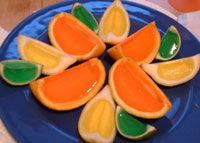 Citrus Themed Jello Shots:   Cut an Orange (or lemon or lime) in HALF and gut it. Mix the jello shot (1 cup hot water, box jello, 1 cup liquor), stir till disolved, then add the jello mix to the half shell and refrig for 3 hours or more. Once solid, slice and serve!