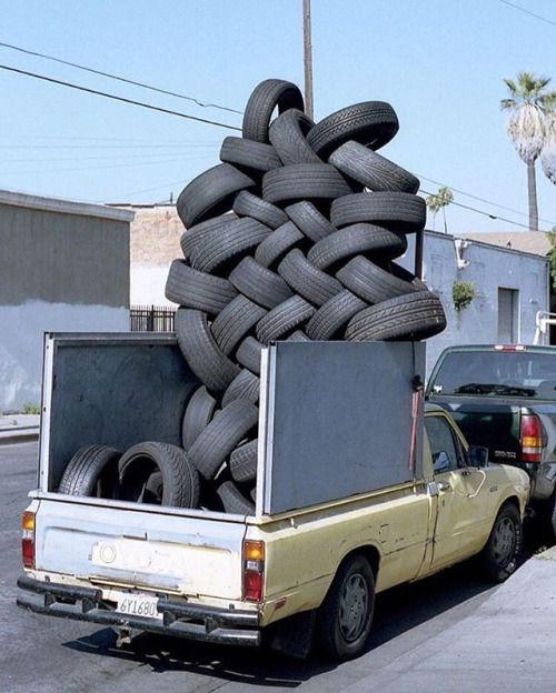 This truck was found on the side of a wonky tire repair shop just southwest of downtown #Los Angeles photographer Jamey Hoag (@hameyjoag) remembers I was on a little walk in the area at around 8:00 AM and turned a corner. There it was: a partially unloaded mound of tires in a dirty little pick up truck. No was one around so I quickly made the photo and kept going. He made the picture in 2012 or 2013 and only rediscovered it while perusing his archives. // #newtopographics #documentingspace…