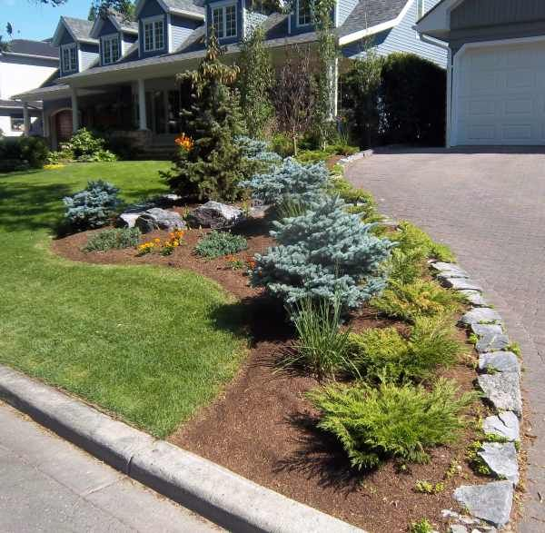 Image detail for -Stone border along driveway surrounding flower bed.