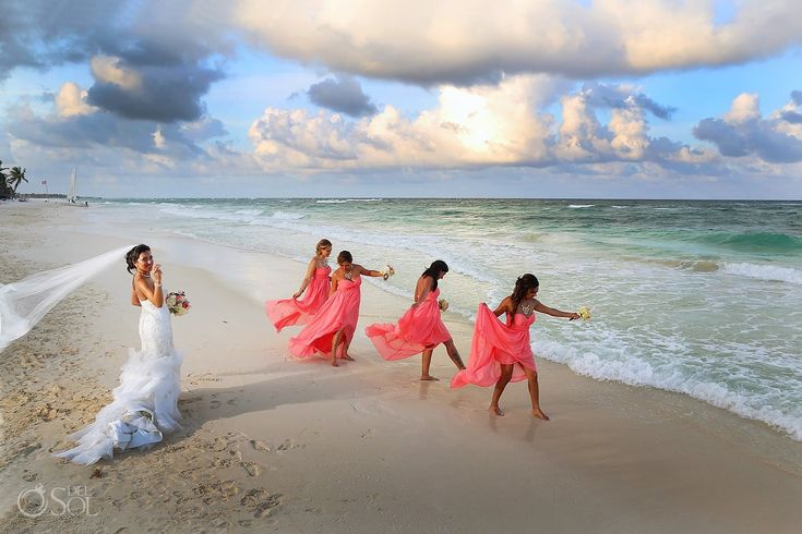 Bridesmaids having a little fun in the waves of the Mexican Caribbean Sea at a destination wedding at Akiin Beach Club Tulum. Mexico wedding photographers Del Sol Photography.