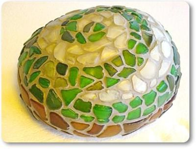Beach Glass Spiral on Rock Mosaic: ~ sea glass project submitted byMaree in Waihi, New Zealand   Just a nice roundy rock I thought would make a good doorstop!   The koru design means