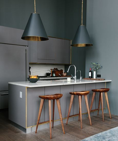 Beautiful grey rooms: Kitchen  Don't be afraid to go all grey. Having an all-grey kitchen looks contemporary and classic and will make any of your food creations and indoor plants pop, especially when paired with white marble and dark-wooden bar stools. Paint with different tones of grey for added depth.
