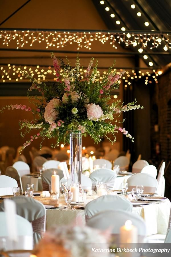 Pink wedding flowers; glass cylinder; tall flower arrangement; reception flowers; pink hydrangeas; pink and white larkspur; with greenery; romantic and classic; tall reception centerpieces   Lisa Foster Floral Design   www.lisafosterdesign.com