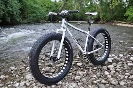Risultati immagini per bici ruote giganti