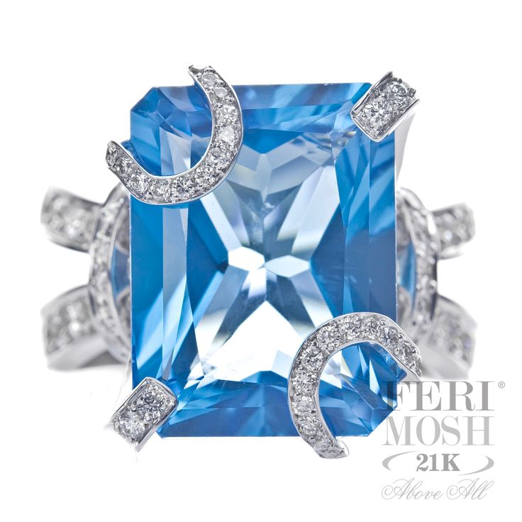 Ocean Bliss Ring - 21K white gold, genuine diamonds, large center Topaz gemstone, high class, high design, and high fashion, will include a customized IGI FERI MOSH Appraisal and the industry leading FERI MOSH five year maintenance free guarantee.