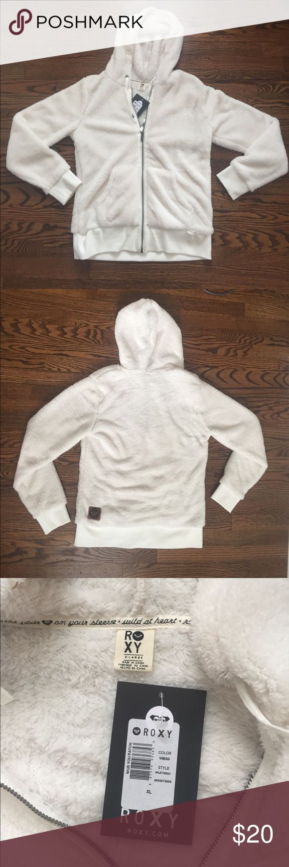 XL Roxy Sherpa Zip Up Hoodie This is a never worn NWT super soft and warm Roxy Zip Up hoodie. It has a cream color with adorable detail on the hood strings. The material is cozy sherpa inside and  out. It also features a Roxy patch on the back, bottom right corner of the hoodie. This is a size XL. Roxy Tops Sweatshirts & Hoodies