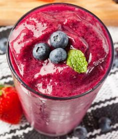 Berry Smoothie 1 cup unsweetened vanilla almond milk 1/2 cup water 1 cup frozen mixed berries 1 scoop whey protein powder 1 tablespoon flaxseed 1 teaspoon chia seeds (Sometimes I throw in a handful of spinach, kale, or a teaspoon of honey.)