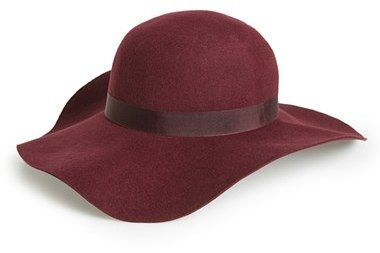 Add a touch of eclectic boho style to your look with a floppy, wide-brimmed felt hat.  Wool. Do not wash. By Topshop; made in the UK.
