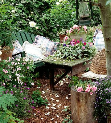 Mulch flooring as cost-saver and easy to install yourself. Tree stump used as side table.