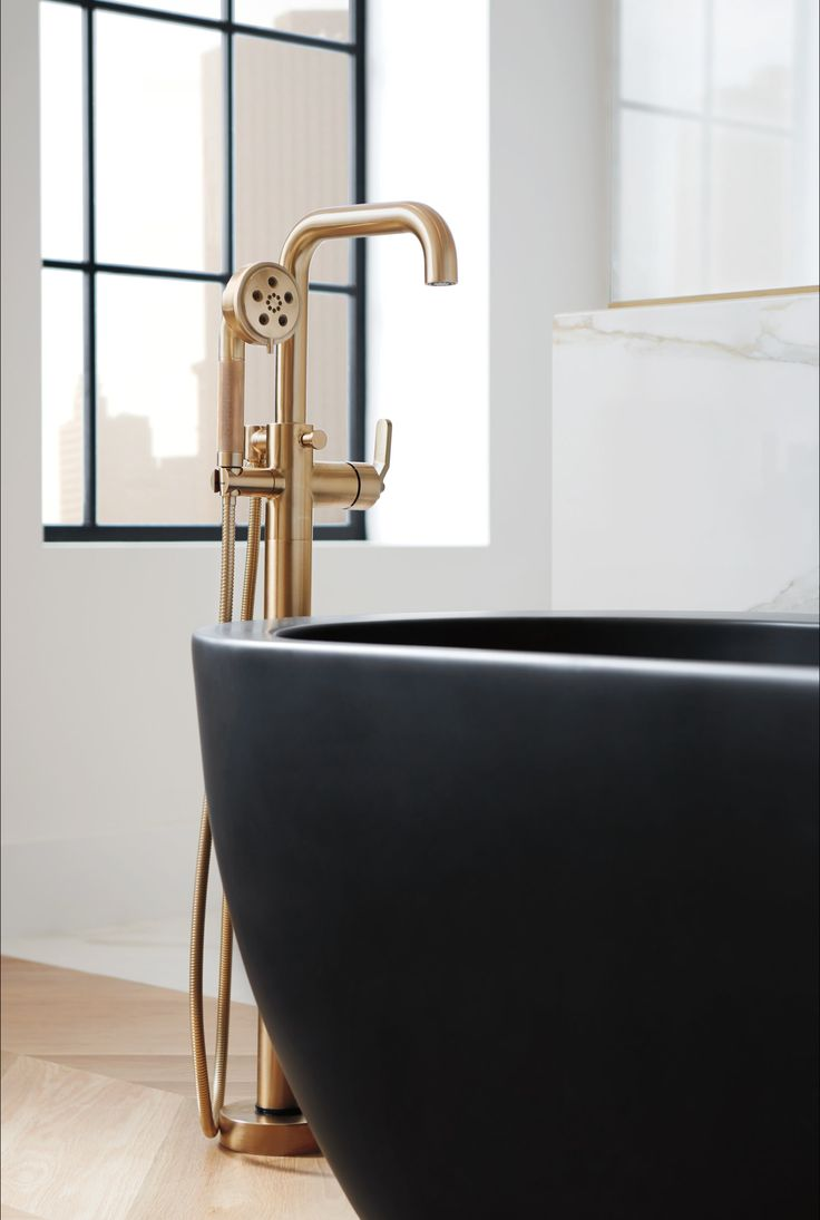 Best bathroom sanitary ware - Brizo Litze Collection Minimal Modern Bathroom Showroom Interior With Black Tub And Brass Fixtures
