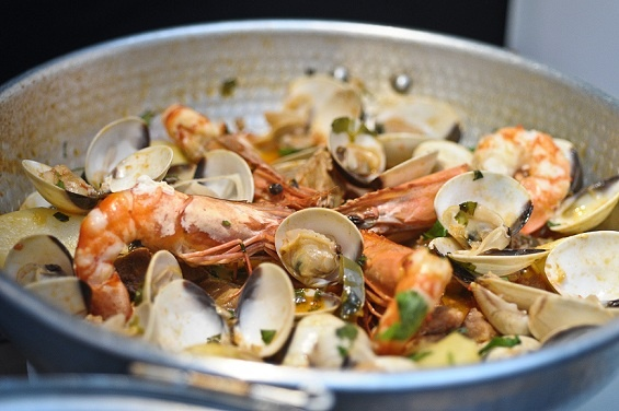 Cataplana de Ameijoas com Carne (Traditional Portuguese Dish from Algarve with Clams, Prawns, Chourico, Bacon, Pork cooked in a Copper Pot served with Potatoes) @ WineNBread