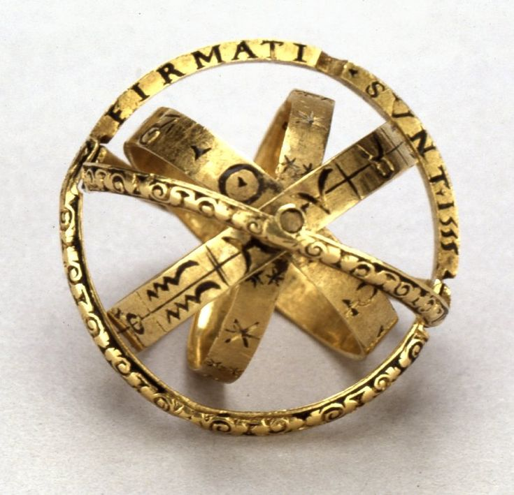 finger-ring / armillary sphere: Sphere-ring; gold; formed of an outer hoop in two parts, interior three hoops almost concealed when ring closed; Inscription Content  VERBO DEI CELI FIRMATI SUNT 1555 DIXIT ET FACTA SUNT IPSE MANDAVIT ET CREATA SUNT [exterior hoop] exterior hoop chased with scrolls on ground once enamelled black, each part has on flat surfaces concealed when ring closed a section of enamelled inscription; three interior hoops plain flat bands engraved and enamelled in black…