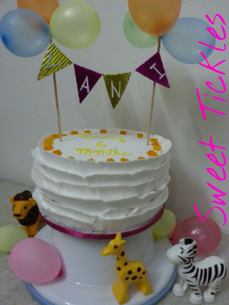 Simple white cake with mango filling for a baby turning 6 months.