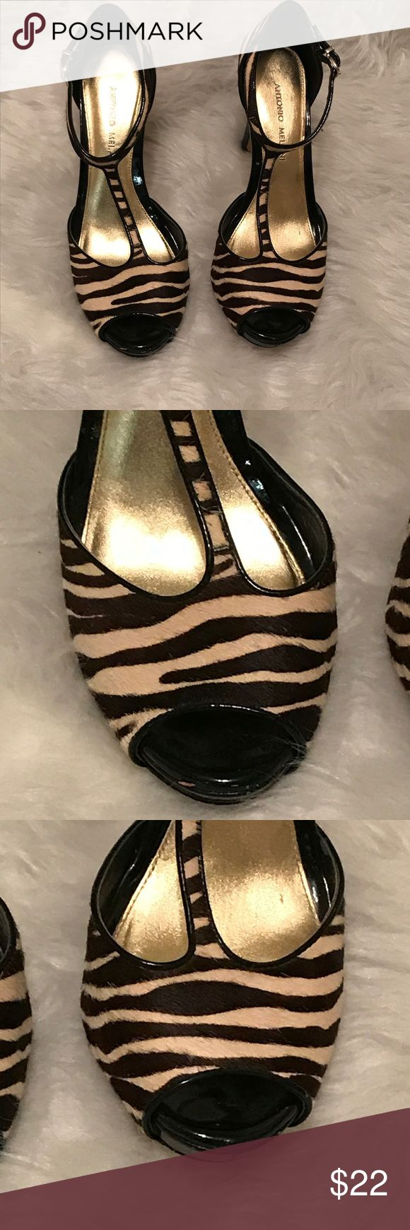 Antonio Melani- zebra stripe t strap heel Antonio Melani size 8 1/2 medium, beige and dark brown zebra striped T strap heel height is approximately 4 inches. Good condition. Signs of wear include the interior part of the strap is rubbing off and a few marks towards the front on the shoe. Refer to the last two photos. Some pitting in the bottom of the shoe. ANTONIO MELANI Shoes Heels