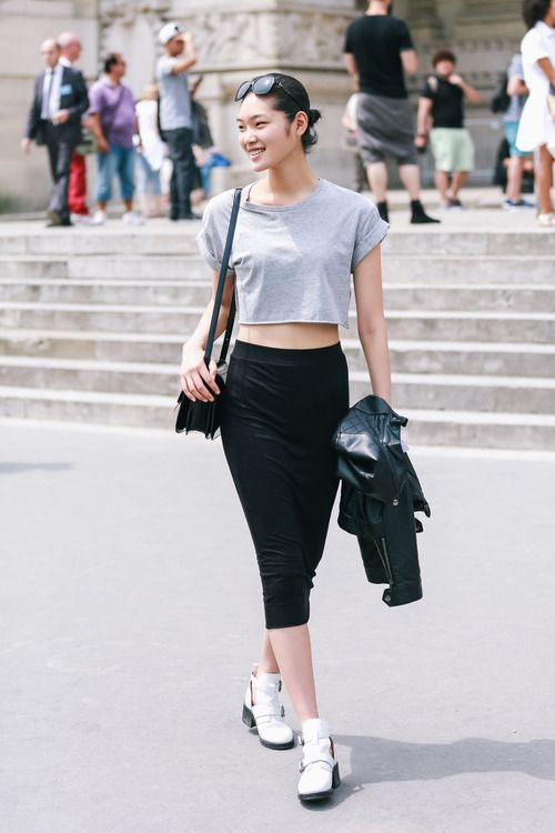 Stay sporty but chic with a grey crop and black tube skirt.