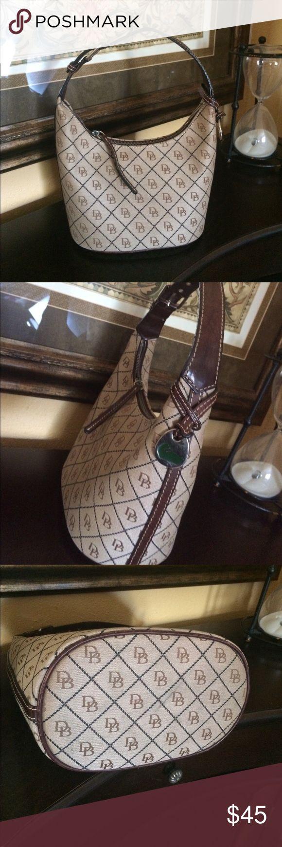 """Dooney & Bourke brown bucket purse Dooney & Bourke brown bucket purse.  Great condition. Adjustable strap.  Measures;  9""""x6"""" Dooney & Bourke Bags"""